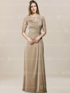 You will look fierce in this long and luxurious mother of the groom dress! Fitted bodice features illusion Lace top and elbow length sleeves. A beaded motif highlights the flattering asymmetric waist. Floor length skirt is ultra-feminine and comfortable. Sexy back has a small keyhole and zipper closure. Available in 60 colors, shown in Cafe.