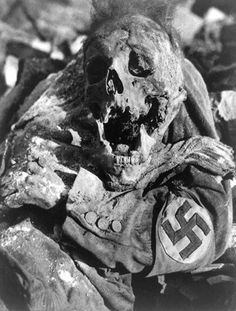 Victim of Dresden bombing during WWII. Decomposing corpse of man with swastika arm band in Dresden, Germany, after the fire bombing during World War II.