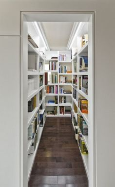 Love the idea of a small walk-in library. Books always have a tendency of looking cluttered our it the open, as do the small kick-knacks that you place on the shelves with them. Minimizes cluttered look, making the space seem bigger.