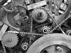 gears, industrial, metal, silver, screws, cold, smooth, meshes tightly together, shiny, turning parts, nuts, bolts, chains, axles