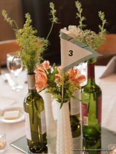 Peach Flowers and Greenery in Milk Glass Vases and Wine Bottle for Wedding Reception Centerpieces -The French Bouquet - Ace Cuervo Photograp...