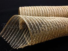 "21"" x 10yd roll of woven poly mesh in a natural color wtih strips of natural jute rope."