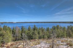 """This is taken from the top of """"Kyrkösvuori"""". There we have a bird watching tower or an observation tower, whatever we would like to call it. This solid rock can be seen on the left side of this photo I've posted earlier. The sun was shining and the sky was blue. This is how I saw it."""