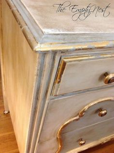 Chalk Paint® Decorative Paint by Annie Sloan. Pure White and a custom mix of Louis Blue/Pure White..clear and LOTS of dark wax. Gold leafing detail and Imported French gilding wax on knobs.