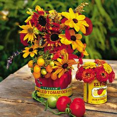 Use empty canned fruit and veggie cans for outdoor flower arrangements.