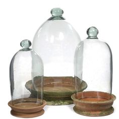 Although the company is based in the Berkshires in Massachusetts, Campo de' Fiori specializes in mossy, aged terra cotta pots with a decidedly foreign flavor. One of our favorites is a handblown glass domed terrarium with a clay saucer: