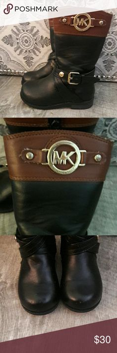 Toddler sz 5 Michael Kors boots Good used condition. Normal wear shown in pictures. Over all still look good. Price reflects the wear Michael Kors Shoes Winter & Rain Boots