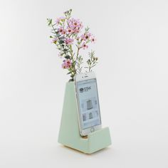 A gorgeous vase and charging station in one! STAK Ceramics Bloom Phone Vase fits a variety of smart phones and allows you to charge your phone with the cord hidden from sight. All we have to do now is pick our favorite color!