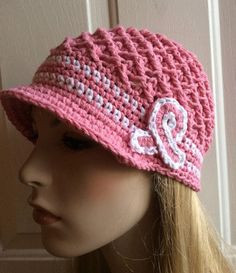 Crochet Breast Cancer hat , with breast cancer logo. This crochet cap is pink with white trim. Comfortable while going thru treatments. Light and…