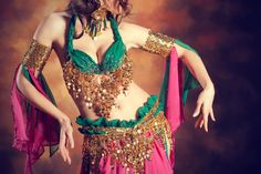 Belly dancer/belly dancing lessons for live entertainment instead of a live band?