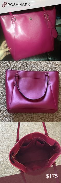 💕Coach  Large Leather Tote Bag - Hot Pink💕 Hot pink leather tote bag from Coach. Very good condition - no signs of wear. Large size - it fits a Macbook Pro laptop inside. Nice to use as a laptop/work/school/mom bag. One pocket on outside of bag, 3 pockets on inside. measurements are in the comments. Coach Bags Totes