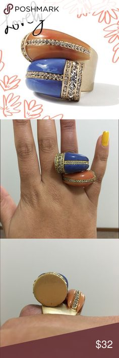 Lia Sophia statement ring  Bought this ring a long ago . Has some slight scratch marks on one side (picture above) size 7 . All stones are in place, matte gold finish no fading looks new. Lia Sophia engraved inside. Orange jasper and blue lapis with black diamond crystals.  Name is Horn ring. ⛔️ No trades ⛔️ ✅Accepting offer please use offer option          happy poshing  Lia Sophia Jewelry Rings