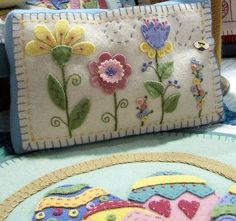 Wool appliqué spring flowers pillow. Couldn't find pattern for sale on site Birdbrain Designs any more.