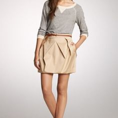 J.Crew Lunette Pleated Bubble Mini Skirt Khaki/Beige color. Gentle use. Silky fabric. Zipper back. Side pockets. Hits mid thigh. Fits as an XS with 25 inch waist and 35 inch hit fit. SOLD OUT in stores and priced at $85. Photos from www.jcrew.com. TINY SNAG ON FRONT. J. Crew Skirts Mini