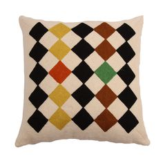 A wool hand embroidered cushion by Gabrielle Soyer 'Salim' hand-stitched embroidered cushion. A hand-embroidered cushion with tightly chain