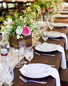 Love the wood farm table.  Also, the wooden flower arrangements.
