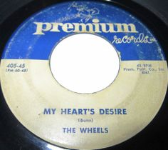 1956 Doo Wop 45 Rpm The Wheels MY HEART'S DESIRE / LET'S HAVE A BALL On Premium 405.. This group was managed by Allen Bunn, Former member of the Larks on Apollo. Bunn would sometimes record with the Wheels. It was Bunn who brought the group to Joe Liebowitz, Owner of Premium, in 1955. In addition to their recordings for Premium, They Also became the Studio Group for the New Jersey-Based Label. They Backed up Vicki Carr, Gloria Lynne and Arthur Lake at Premium.