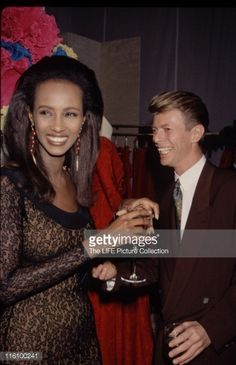 Singer and musician David Bowie with his girlfriend, supermodel Iman, 1990.