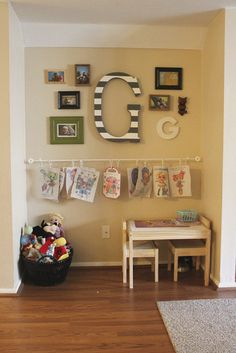 Honeybee Vintage: Making a Creative Space -- curtain rod and hooks for kids to hang artwork from, super cheap way to get a gallery space for little artwork!
