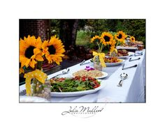 Lovely buffet set up for a summer barbecue/dinner held outdoors, whether at a country club, a park, restaurant,  catering hall, hotel's banquet hall, or even outside of your own home (This will also depend on the size of your backyard as well as the number of guests you are expecting to your event).