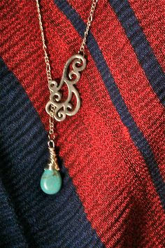 Drop through the swirl necklace by standoutdesigns on Etsy, $20.00
