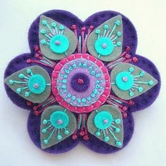 Stargazer felt brooch by Appliqué-designed by jane, via Flickr