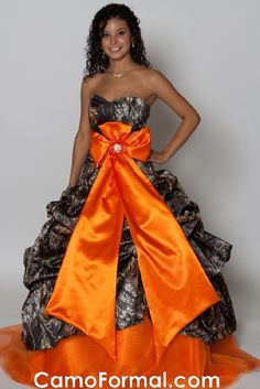 Camo prom dress with orange bow in front Bad Bridesmaid Dresses, Camo Prom Dresses, Camo Dress, Straps Prom Dresses, Cute Dresses, Strapless Dress Formal, Formal Dresses, Sweet Fifteen, Haute Couture