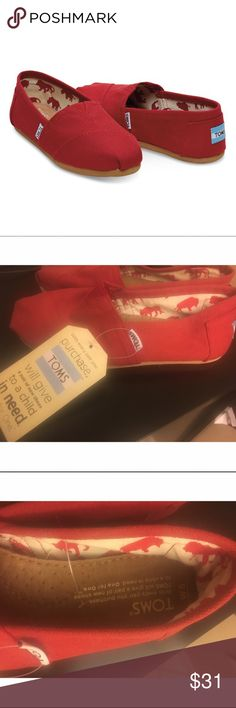 TOMS RED CANVAS WOMEN'S CLASSICS -New with tags.                                                         -Canvas upper with TOMS toe-stitch, and elastic V for easy on and off -TOMS classic suede insole with cushion for comfort -Latex arch insert for added support -Selling because I bought the wrong size, but I own in different color and they are very comfortable walking shoes. TOMS Shoes Flats & Loafers