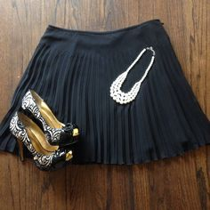 Express pleated skirt Black pleated skirt. Very flowy. 17 inches from top to bottom, and fully lined. Express Skirts Mini