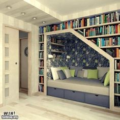 I love this! I especially like that the did wallpaper inside the nook to make it a separate space. At first I thought the slanted roof was kind of weird for a bookshelf, but it gives the reading area a private get-away feel.This could also work below a set of stairs