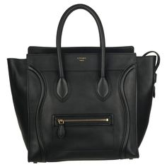 Curved, stitched accents, a front zipper pocket and an imprinted goldtone nameplate highlight this elegant Celine tote bag. Constructed of smooth black leather, this designer handbag is finished with double rolled handles and three interior pockets.