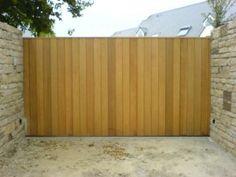 Portail coulissant plein, en bois lames verticales, Magny en Vexin 95