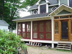 Screen porch using doors.  Love this idea of using screen doors to screen in a porch! How clever