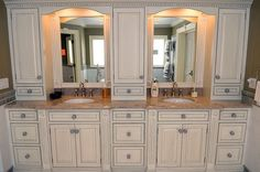 Side-by-side sinks with vanity mirrors and cabinets in master bathroom