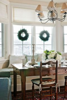 orig from Traditional Home magazine -- wreaths on window, for dining room. I would use Command hooks...