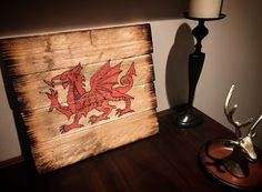Welsh Dragon burned onto a wooden board for home decor sign. Pyrography and paint pens.