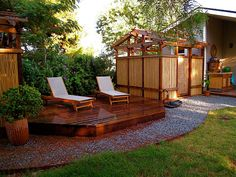 Backyard sun deck with outdoor shower surrounded by bamboo fencing