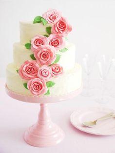 Simple, yet elegant, rose wrapped wedding cake.