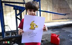 Children in war-torn Syria have been pictured holding up photos of Poké