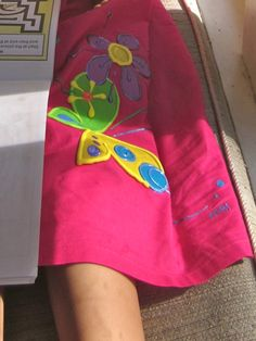 Hand-painted applique & detail on NiGi's ribbon-strap dress from their Rainbow collection