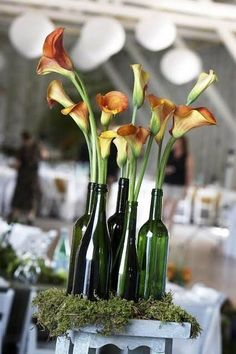 wine bottle centerpieces for wedding - I have a year to collect, and can choose my wine based on how neat the bottle is!
