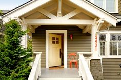 1918 Craftsman bungalow after remodel - love the colors- cream, green, with pop of orange