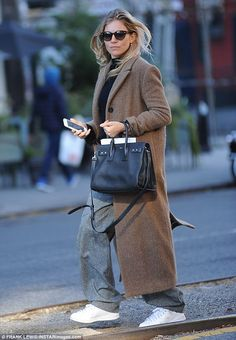 Natural beauty: Sienna Miller looked to be enjoying a break from her jam-packed schedule a...