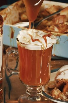 Give your night a delicious upgrade with a Hot Caramel Cider, a drink that combines the spiced flavor of a Captain Morgan cocktail and the fun of spoiling yourself. INGREDIENTS: 2 oz Captain Morgan Original Spiced Rum, 6 oz Fresh Apple Cider, Caramel Drizzle, 1 Cinnamon Stick, 1 Apple Slice. Fun Drinks, Yummy Drinks, Alcoholic Drinks, Yummy Food, Delicious Recipes, Captain Morgan, Christmas Drinks, Christmas Baking, Fall Recipes