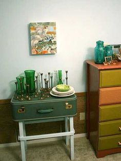 table in vintage style with antique glass bottlesand artwork