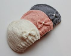 This charming hand knitted hat in white, pink or grey color with a little bow. This hat is very soft as it is knitted from a light weight