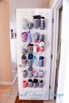 An over-the-door pocket shoe organizer (in the hallway next to the coat rack) for winter hats, gloves, and umbrellas.