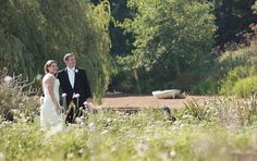 Bride and groom in the field at Grittenham Barn