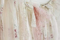 This beautiful shabby chic backdrop is made from floral cotton, chiffon, and lace in shades of pink, nude and ivory. The edges are left raw and slightly frayed and the lengths are left gently uneven to add to the overall shabby look. This photo booth backdrop will look romantic