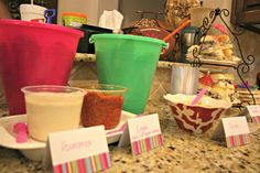 Buckets with shovels for chips and cheetos for luau themed party. Cute idea!